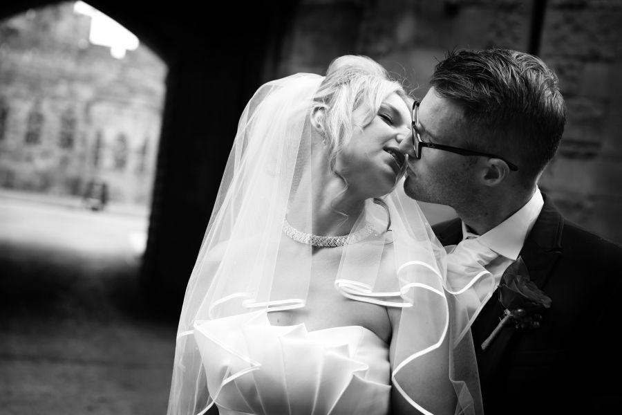 Black and white bride and groom kiss